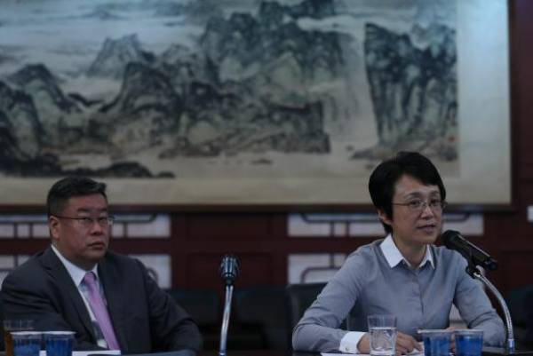 Ministro Song Yang e Ministra Conselheira Xia Xiaoling